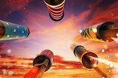 Bottom view of fireworks rockets launching into the sky, free space for text. Concept of celebration poster