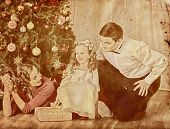 Nostalgy Christmas family with child girl dressing Christmas tree. Xmas tree presents for happy peop poster