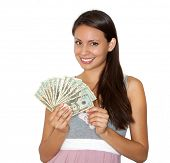 stock photo of money prize  - Pretty smiling beautiful woman holding cash - JPG