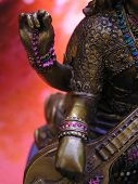 foto of saraswati  - close up shot of a saraswati statue showing her hands Saraswati is the Hindu Godess of Music - JPG