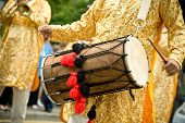 stock photo of dhol  - musician playing a traditional asian dhol drum - JPG