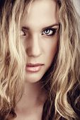 stock photo of blonde woman  - closeup portrait of young beautiful blonde woman with long curly hair and natural fresh make - JPG
