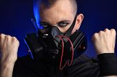 picture of skinhead  - Shot of a conceptual man in a respirator - JPG
