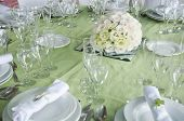 picture of wedding table decor  - detail of a wedding table set for fine dining with a estomas arrangement - JPG