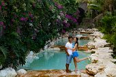 Couple Smiling. Multiracial Couple Hugging. Couple On Vacation. Multiethnic Couple At The Swimming P poster
