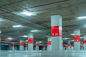 Empty Underground Car Parking Lot. Underground Car Parking Garage At Shopping Mall Or International  poster