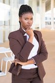 Serious Confident Business Professional Posing Near Office Building. Young African American Business poster
