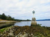 View Of A Port Hand Day Beacon At Low Tide At The End Of A Reef On An Island.  The Port Hand Day Bea poster