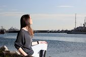 picture of piraeus  - Young woman at the port of Piraeus Greece - JPG