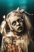 A portrait of a scary blonde zombie girl. Halloween. Horror film. poster