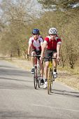 pic of veer  - Two cyclists playing a tactical game during a road race on their bicycles - JPG