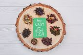 Keep Calm And Drink Tea Concept. Assortment Of Dry Tea On Round Tree Slice. Flat Lay Composition. poster