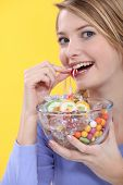 Young woman eating sweets