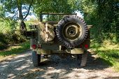 A Back View Of American Military Vintage Vehicle Ww2 Time poster