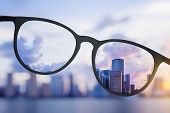 Abstract Bright City View Through Eyeglasses poster