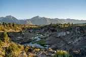 Winding Creek Of Hot Creek Geological Site In Mammoth Lakes California At Dusk Sunset, With Backligh poster