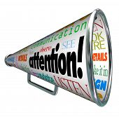 foto of attention  - A bullhorn megaphone showing the word Attention and many words related to communication - JPG