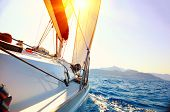 stock photo of wind-power  - Yacht Sailing against sunset - JPG