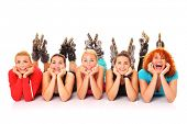 A picture of five girl friends resting over white background with their roller blades on