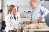 pic of hip replacement  - Doctor Examining Male Patient With Hip Pain - JPG
