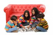 stock photo of 13 year old  - indian children playing board game at home - JPG