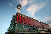 Sky Tower With Building In Front poster