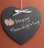 stock photo of thursday  - Happy Thanksgiving message written on heart shape blackboard with turkey motif decoration - JPG