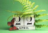 pic of save earth  - Earth Day save the date white block calendar April 22 with butterfly and ferns against a green background - JPG