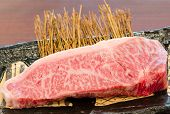 stock photo of shabu  - Close up Freshness Marbled on Japanese Kobe Matsusaka Beef for BBQ On The Plate in Restaurant King of Beef - JPG