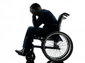 stock photo of handicapped  - one handicapped man head in hands in silhouette studio  on white background - JPG