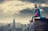 stock photo of adolescent  - A young boy dreams of becoming a superhero - JPG