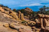 stock photo of granite dome  - A View of the Amazing Granite Stone Slabs and Boulders of Legendary Enchanted Rock - JPG