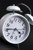 picture of tick tock  - Beautiful white old fashion alarm clock against black background - JPG