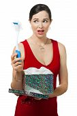 stock photo of disappointed  - A disappointed woman looks at dish brush gift - JPG