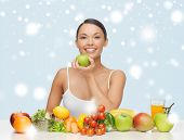 food, nutrition, slimming, diet concept - healthy woman with lot of fruits and vegetables in front