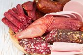 image of sausage  - Different sausages on wooden board close up - JPG