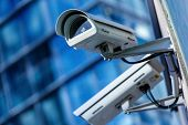 stock photo of cctv  - close up of security camera and urban video - JPG