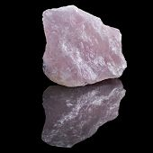foto of rose-quartz  - Natural Rose Quartz crystal with reflection on black surface background  - JPG