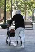 image of elderly woman  - Elderly woman using walker - JPG