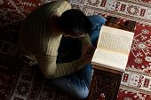picture of muslim man  - Young Muslim Man Is Reading The Koran - JPG