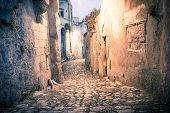 stock photo of sassy  - sassi the historic center of the city Matera in Italy details of old street - JPG