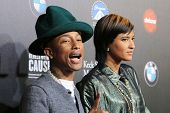 LOS ANGELES - MAR 20: Pharrell Williams, Helen Lasichanh at the 2nd Annual Rebels With A Cause Gala
