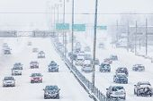 Постер, плакат: Snowstorm On The Highway During The Rush Hour