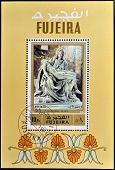 FUJEIRA - CIRCA 1971: A stamp printed in Fujeira shows The Pieta by Michelangelo circa 1971