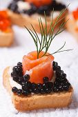 Постер, плакат: Canapes With Black Sturgeon Caviar And Salmon Fish