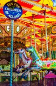 stock photo of school carnival  - View of Carousel with horses on a carnival Merry Go Round - JPG