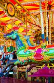 foto of school carnival  - View of Carousel with horses on a carnival Merry Go Round - JPG