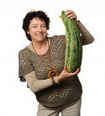 stock photo of phallic  - Woman holding big courgette  - JPG