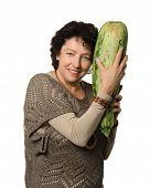 image of phallic  - Woman holding big courgette  - JPG