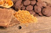 image of bonbon  - chocolate bar shredded chocolate and bonbons on a wooden table selective focus - JPG
